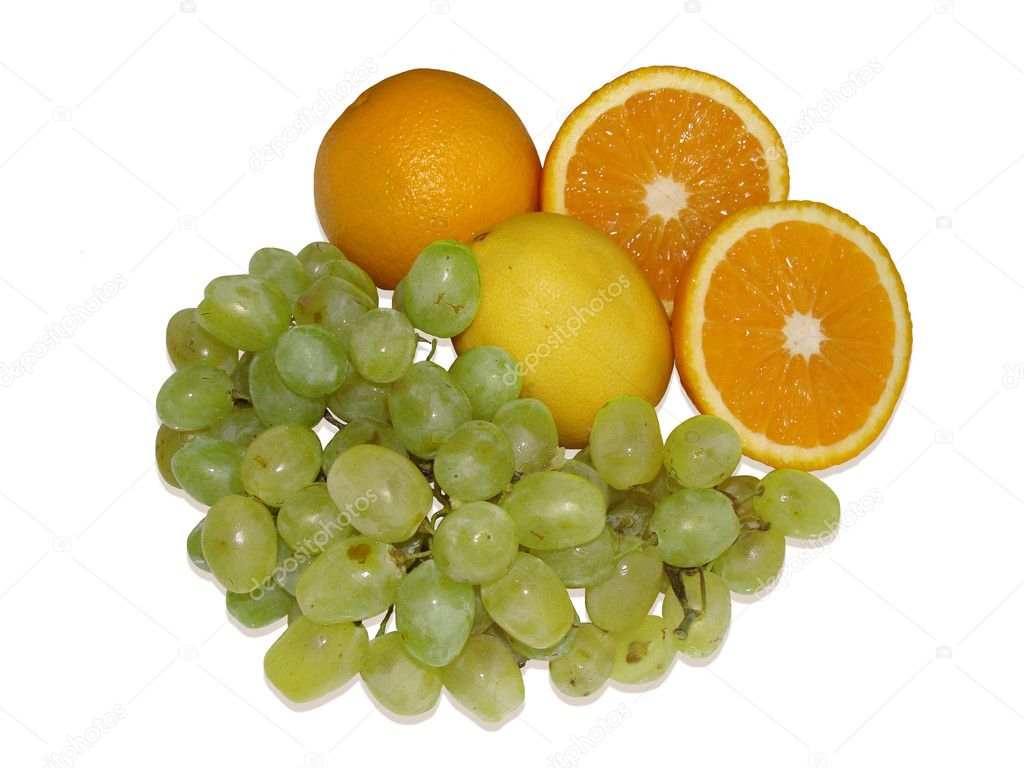 Fruits grapes, oranges and a lemon