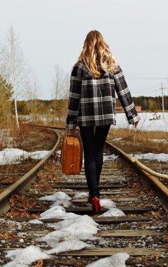 Girl on railroad