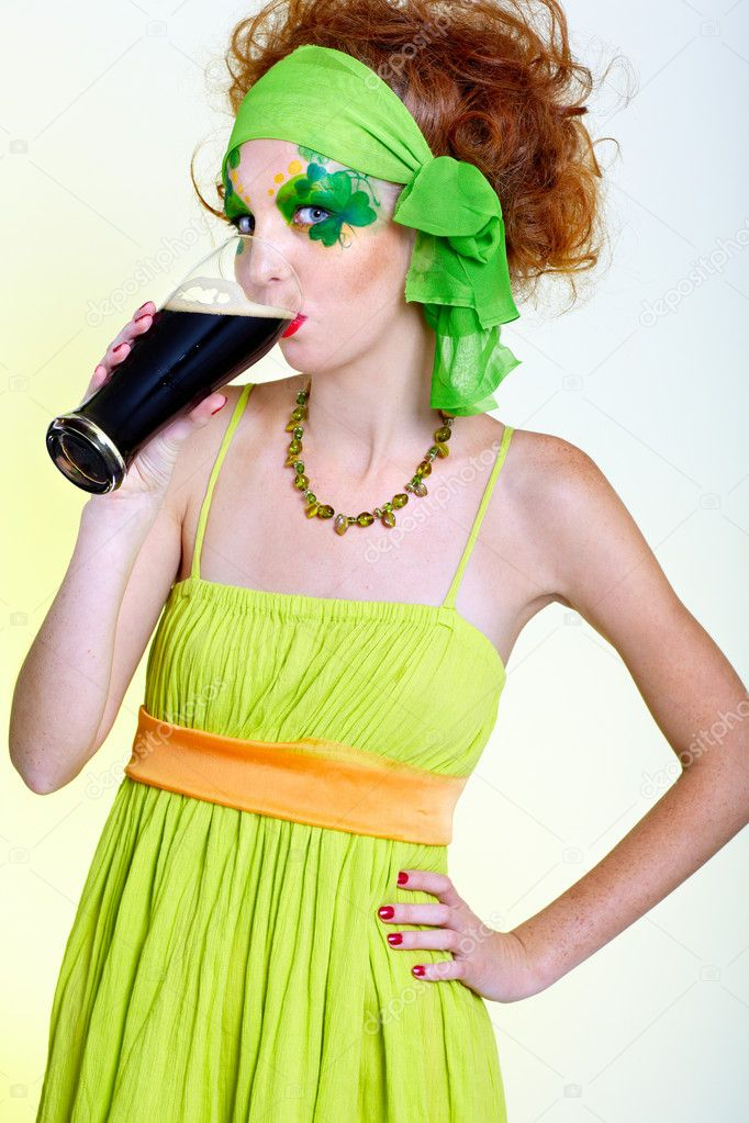 Red-haired girl drinking stout