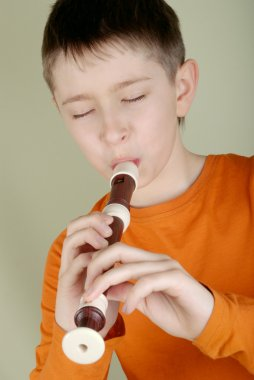 The boy playing the flute