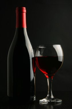 Wine bottle and footed glass