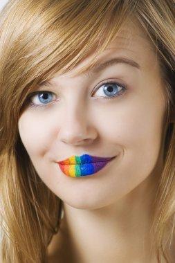 Surprised woman with rainow lipstick