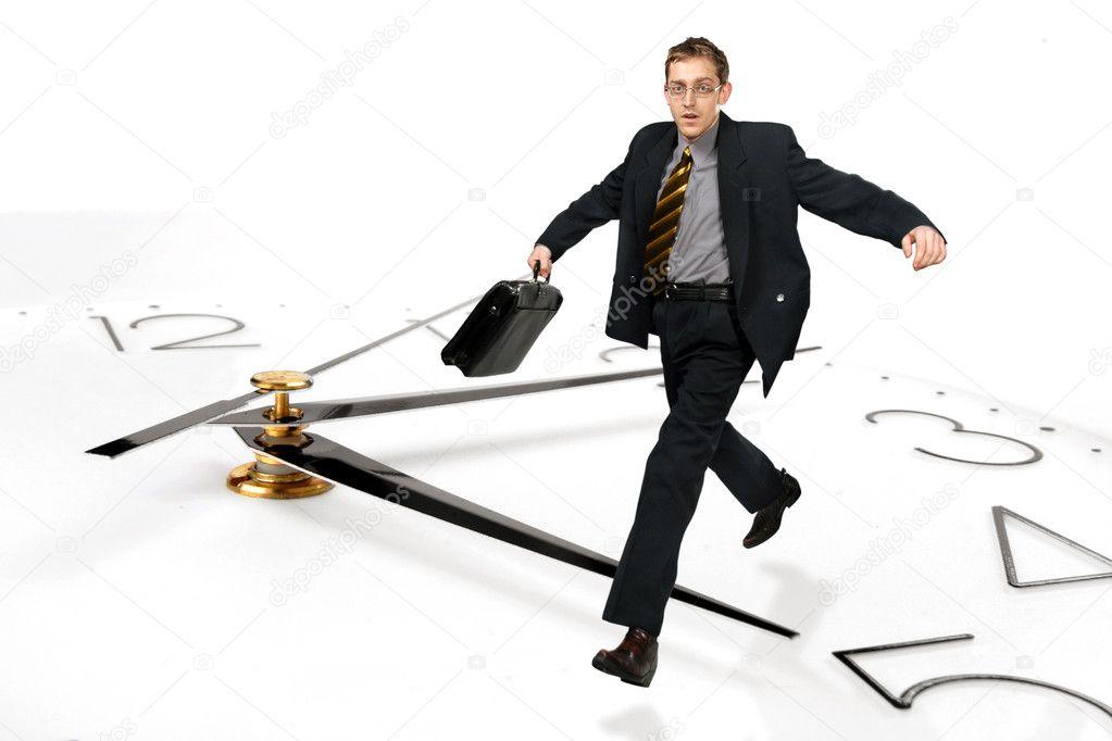Businessman jumps over time
