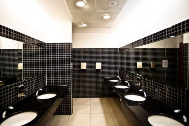 Empty restroom interior with washstands,