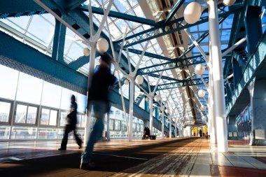 Blue foot bridge with metal construction
