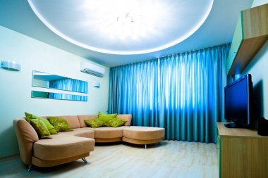 Modern blue room with TV and sofa