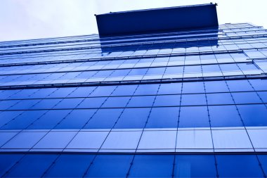 Abstract crop of modern office skyscrape