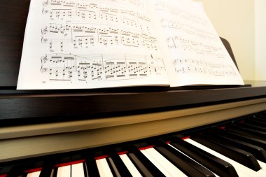 Piano and music paper