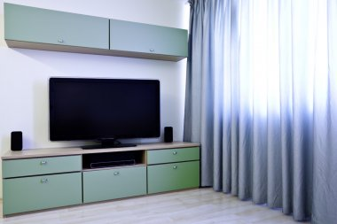 Corner in modern room with TV