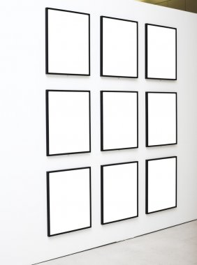 Nine empty frames on white wall
