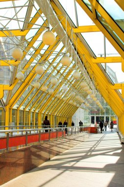 Yellow corridor blue sky windows