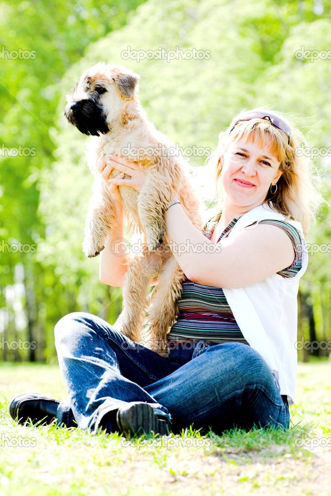 Terrier dog and woman