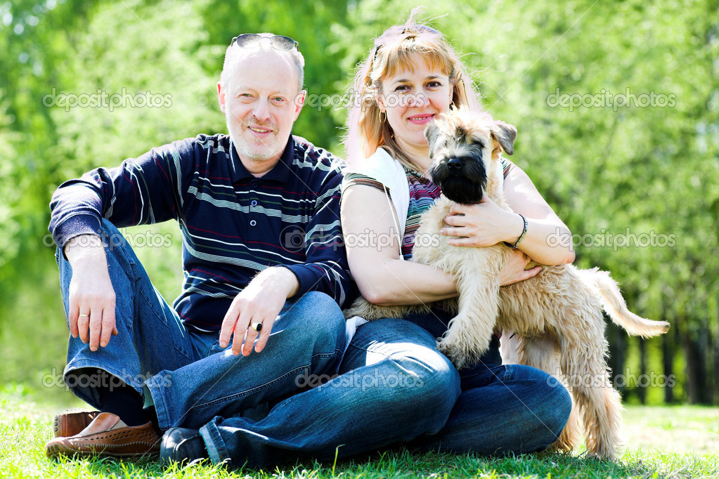 Terrier dog and family