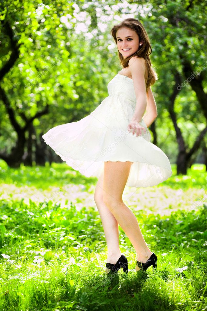 Smile girl dance in white dress