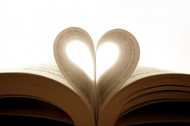 Pages of a book curved into a heart shap
