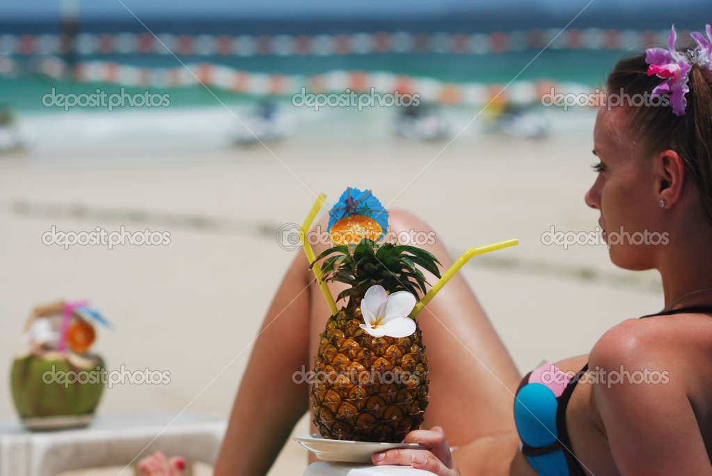 Girl with tropical cocktail