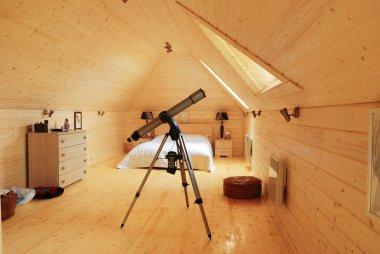 Wooden bedroom with telescope