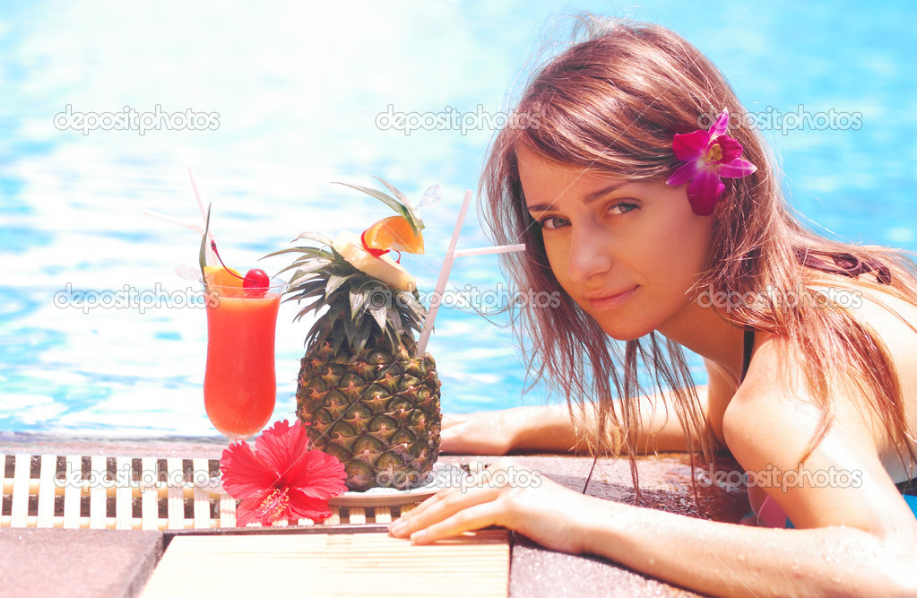 Girl in tropical pool