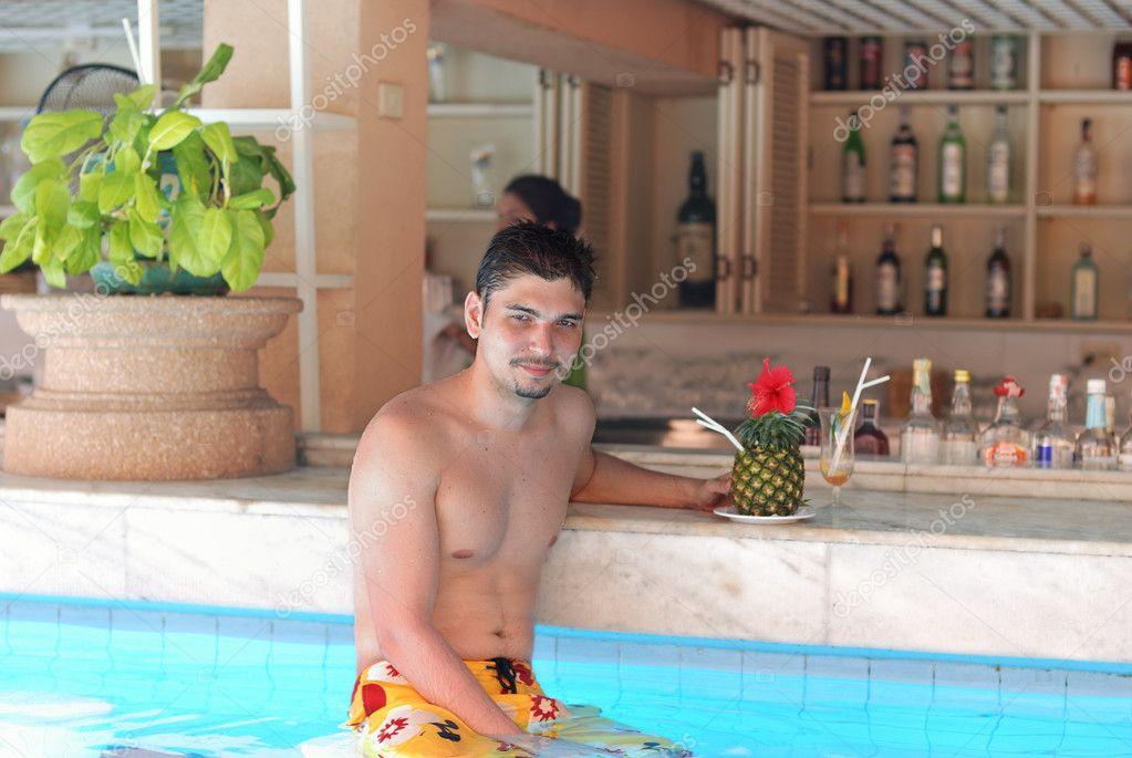 Man in tropical pool bar