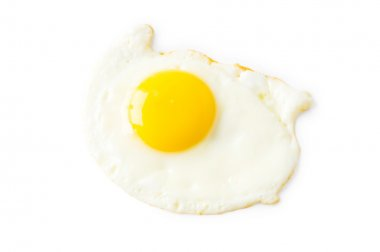 Fried egg isolated on the white
