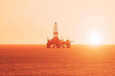 Oil platform at the sunrise