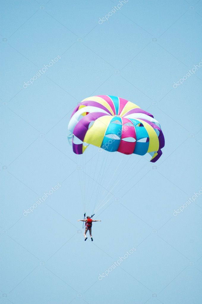 Multi coloured parachute over the sky