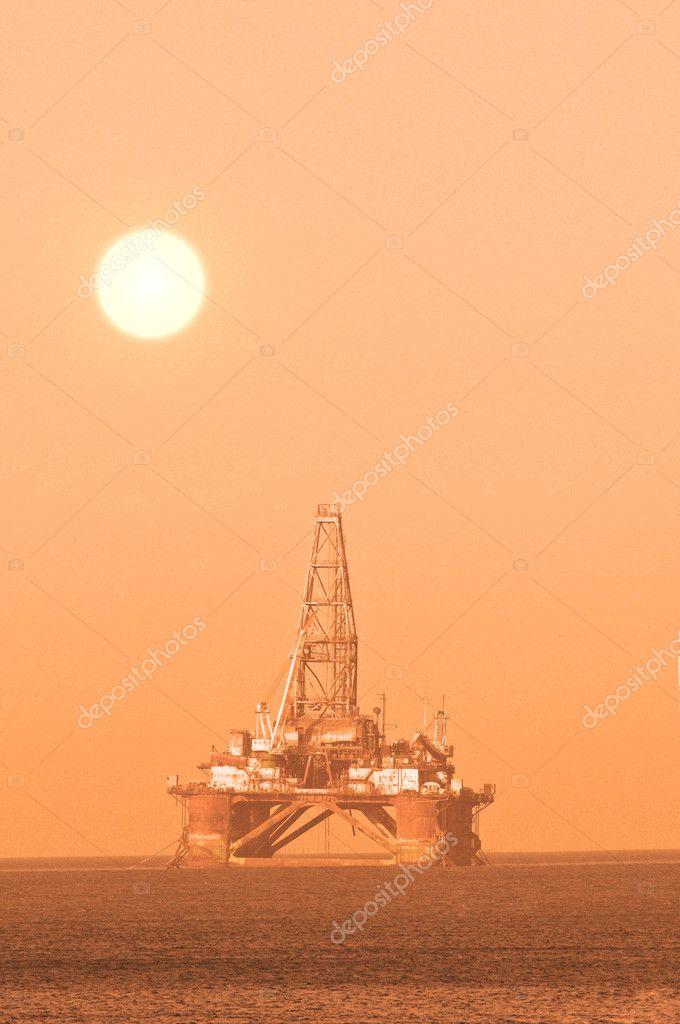 Oil platform during sunset