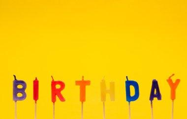 Happy birthday isolated on the yellow