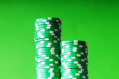 Stack of green casino chips