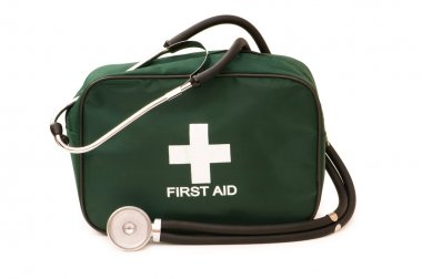 First aid kit and stethoscope isolated