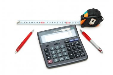 Calculator, measuring tape and pens