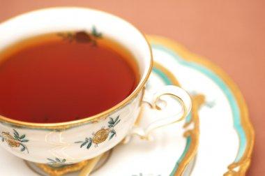 Cup of black tea on biege