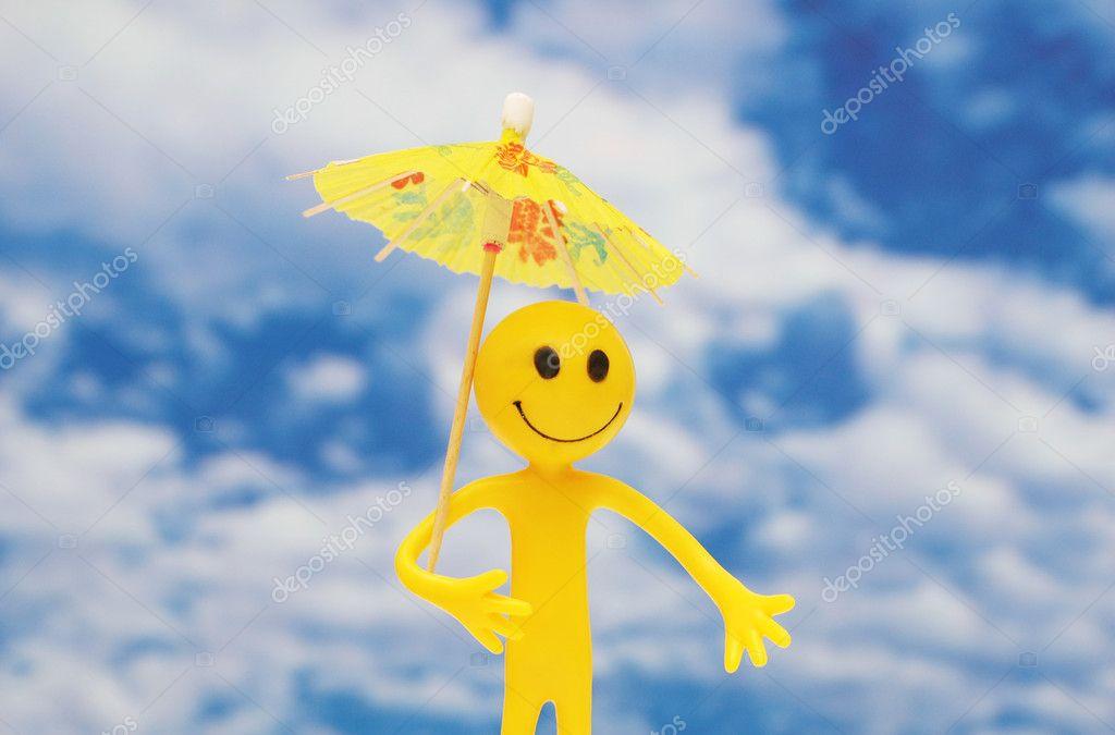 Smilie with yellow parasol enjoying sun