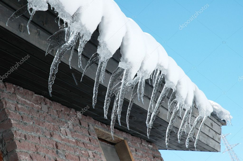 Row of icicles on a bright day