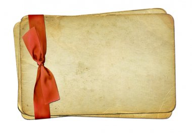 Grunge old papers with red bow on isolat