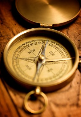 Close up view of the compass on old paper stock vector