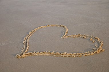 Sand drawing hearts on sand stock vector