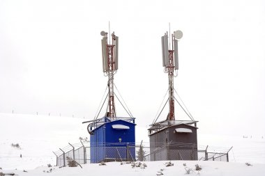 Two GSM towers in winter