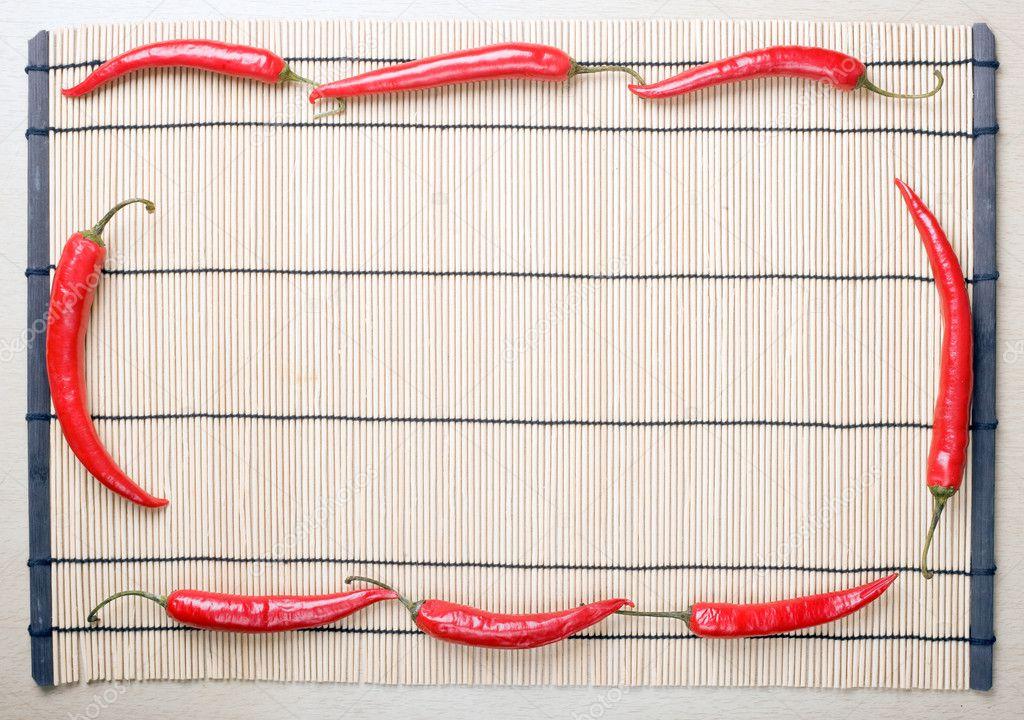 marco de chiles en estera — Foto de stock © svyatoslavlipik #1273489