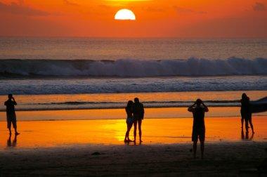 Tourists viewing sunset