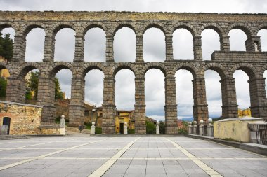 Antique aqueduct in cloudy day