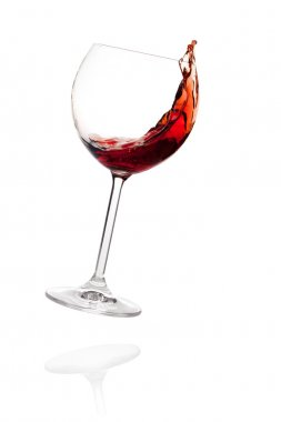 Red wine in falling glass