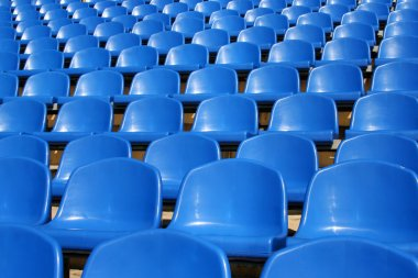 Empty plastic seats in a stadium