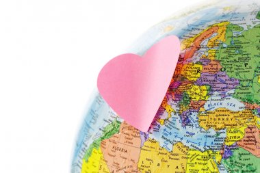 Earth globe and paper heart
