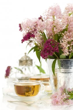 Herbal tea and flowers