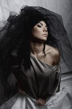 Under a veil of secrecy. Beautiful woman
