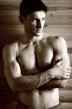 Sepia portrait of brawny gay