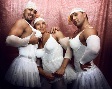 Strong men in suits of ballerinas.