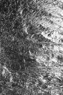 Texture of crumpled foil paper close up