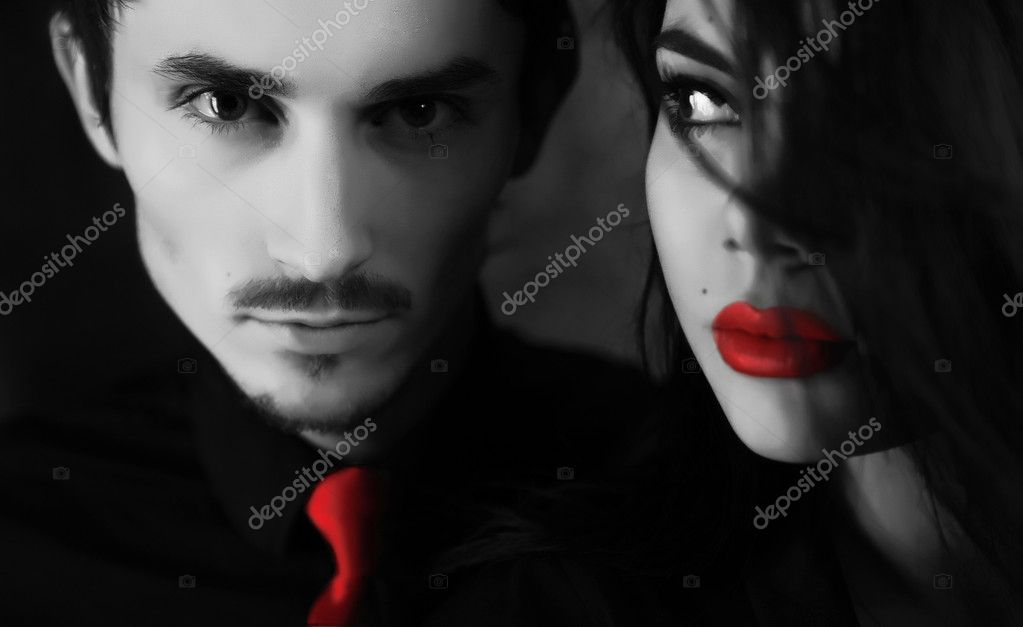 Young sexy couple on black background
